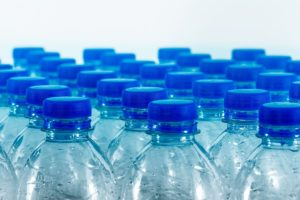 stock photo of clear plastic water bottles with blue caps