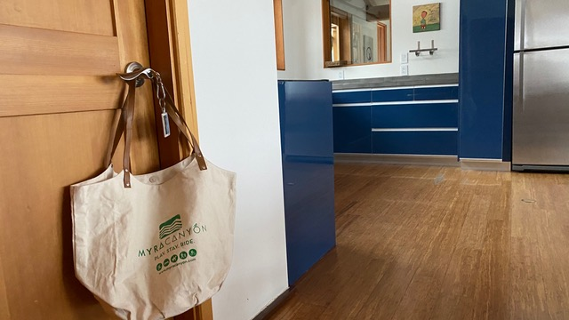 photo of a reusable cloth shopping bag hanging from a door to a suite at Myra Canyon Ranch in Kelowna, British Columbia, Canada.