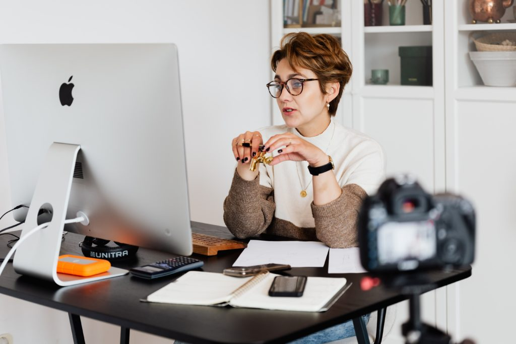 image of a woman in her office working from home, looking at her computer screen